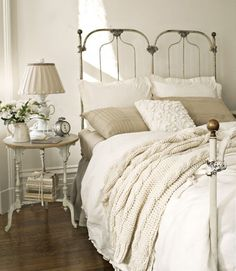 Wrought iron bed + white & cream + hardwood floor