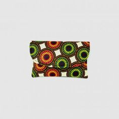 Fashionable and functional. This unique Kitenge Fabric clutch will add that perfect splash of color to any outfit. Perfect for those nights out when you only want to tote around the essentials. Handmade in Kenya. Find the color and design that speaks to you at www.themaasaimarket.com