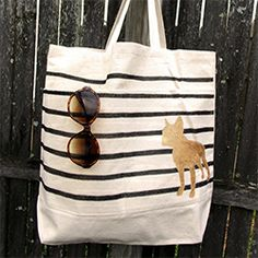 Tired of generic, flimsy reusable bags? Update a blank one with fabric markers, gold paint and an animal silhouette.