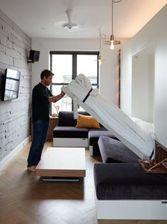 Modern Murphy Bed with Desk . Modern Murphy Bed with Desk . sofa Lit Escamotable Murphy Bed Over sofa Studio Apartment Furniture, Apartment Interior, Apartment Design, Apartment Ideas, York Apartment, New York Studio Apartment, Apartment Lighting, Apartment Checklist, Apartment Sofa