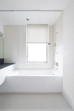White bathroom, Flip Flop beach House in California by Dan Brunn _