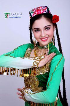 Uyghur girl in traditional dress.