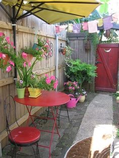 My old court yard- everything is recycled- even the umbrella that I cut in half and mounted to the fence.