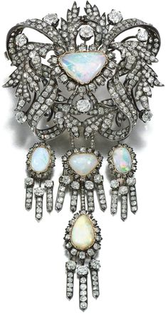 Opal and diamond corsage ornament, mid-19th century.    Designed as a series of ribbons and leaves, to a central cabochon opal within a floral border, set with cushion-shaped, circular-cut and rose diamonds, suspending a series of four tassels similarly set, brooch fitting; further accompanied by a jabot pin, each terminal set an oval cabochon opal within surrounds of cushion-shaped and circular-cut diamonds, part illustrated. Sotheby's.