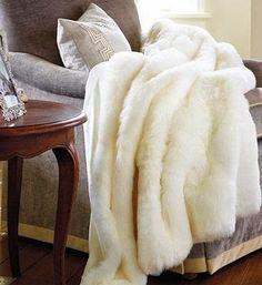 www.eyefordesignlfd.blogspot.com  Make Your Interiors Trendy With White Faux Furs. El genero y color del sillon y el almohadon bordado