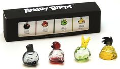 """Angry Birds Perfume Set (Smells like Slingshots?) Air Val International is creating gift sets of perfumes based on the Angry Birds video games. The travel sized Angry Birds miniatures set has four 5ml perfumes in the shape of the Red Bird, Yellow Bird, Black Bird and King Pig. """"Wow, you smell great, what are you wearing?"""" """"King Pig"""". Hopefully it smells better than it sounds... X"""