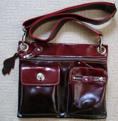 Roots Canada messenger bag in red to black ombre leather