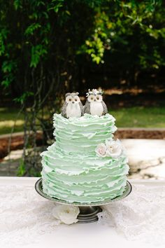 Cute mint ruffled cake with owl topper