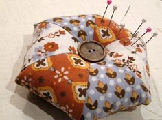 free pattern- 'Hand Pieced Hexagon Pincushion', This is cute Pincushion with Vintage Style! The Shapes are Simple so the Piecing is easily done by hand- this would even be a Great Pattern for Beginner's or Teaching Kids to Sew! Hidden bonus: It's Reversible!! The reverse side of the sample is Patchwork Squares but you could do them identical, a solid back or whatever you like!