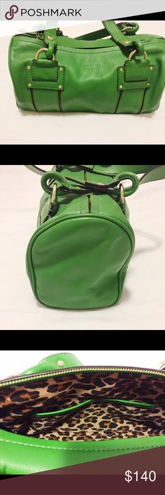 Kate Spade Handbag ⭐️⭐️ PRICE REDUCED!! ⭐️⭐️ Beautiful Kate Spade Green Handbag. Like new condition! Fun size and shape with gold accent hardware on the outside. Zipper close. Inside find a surprise with clean cheetah print, a zipper pouch, along with two pockets to place your cell phone and other things. Beautiful bag that won't last long!  Also included is a dust bag to keep it in fantastic condition. kate spade Bags Shoulder Bags