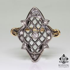 Period: Victorian (1836-1901) Composition: 18K gold and silver. Stones: - 1 Single cut diamond of H-SI3 quality that weighs 0.10ctw. - 10 Single cut diamonds of H-SI2 quality that weigh 0.25ctw. Ring