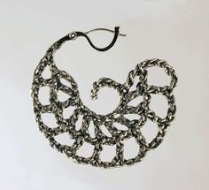 Ashley Stevens crochets items and casts them in silver as we see from this earring