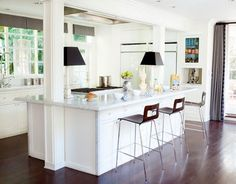 White and Open Kitchen - When you're stuck with beams and columns in the kitchen, probably from an old pass through, here's an idea to open up the space.