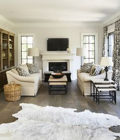 The perfectly neutral living room tv above fireplace dark floors white animal rug furniture arrangement baskets Home Living Room, Living Room Furniture, Living Room Designs, Living Room Decor, Living Spaces, Cream Furniture, Geek Furniture, Fireplace Furniture, Trendy Furniture