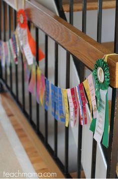 swim ribbon garland: what to do with summer swim ribbons - teach mama Award Ribbon Display, Horse Ribbon Display, Horse Show Ribbons, Award Display, Display Ideas, Ribbon Wall, Ribbon Garland, Swim Ribbons