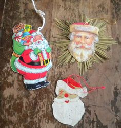 Vintage Santa and Father Christmas Package, Gift Ties or Ornaments. Three vintage foil, glitter and tinsel adorned Christmas items to be used as gift package ties, decorations or tree ornaments. Two date to the 1950's or 60's and the other dates to the 1980's.