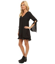 Lucy Love Aquarius Dress Black 2 - SKU 7936622. Revive '60s style with an infusion of Boho chic from the Lucy Love® Aquarius Dress. Semi-sheer fabric lends a chic, flowing drape. Sloping V-neck. Split cuffs with tie detail. Deep, V-cut back with tie at neckline. Hem falls mid-thigh. Fully lined. Body and lining: 100% polyester. Made in the U.S.A.