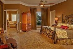 Traditional Master Bedroom with flush light, Crown molding, High ceiling, Ceiling fan, limestone tile floors, Carpet