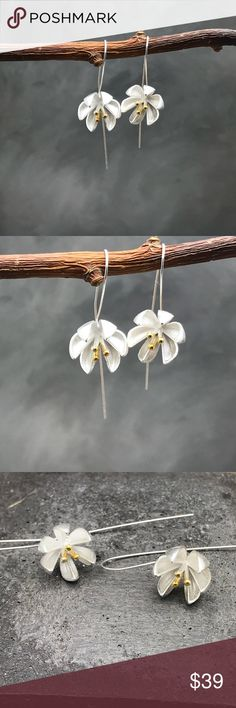 "Long silver flower earrings Sterling silver flower earrings with a small touch of gold. Organic motif jewelry is timeless. I love these pair. Super delicate hooks. Total length 2.4"".i can make it shorter.  Disclaimer: these aren't made by me. I love them and selected them as an addition to my collection. Matana Jewelry Earrings"