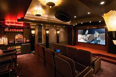Jerry Rice's home theater! part of his 20,000 sq ft home, wow! Love the concession stand as much as the theater