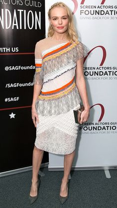 KATE BOSWORTH in a multi-color Peter Pilotto dress with lace panels, a metallic Lee Savage clutch, grey suede Kurt Geiger London pumps and Harry Kotlar hoops at a screening for her movie The Art of More in L.A.