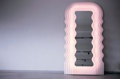 Ultrafragola, Ettore Sottsass, Poltronova, 1970 Mirrored glass with vacuum-formed opaline acrylic with pink neon light.