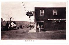 BC – QUESNEL, Reid, Carson Streets, Bridge, Owens Clothing c.1940s RPPC