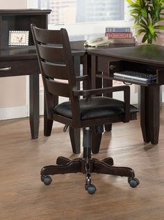 "This desk chair is perfect to go in your home office.  It has a merlot finish and a black vinyl seat.  The chair height can be adjusted and it has castered wheels.   It measures:  40""X20""X19""H"