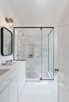 One of the bathrooms of the family house with white marble and elegant design. Une des salles de bains de la maison familiale au marbre blanc et design éléga… One of the bathrooms of the family house with white marble and elegant design Modern Bathroom Design, Bathroom Interior Design, Bathroom Designs, Modern Bathrooms, Tiled Bathrooms, Bathroom Showers, Luxury Bathrooms, White Bathrooms, Shower Designs