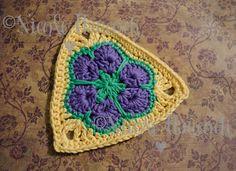 African Flower Triangle - this is a cute flower triangle motif that can be used for bunting, blankets, bags, etc. They are quick to work up and don't use very much yarn and would make a great stash buster project. Crochet Bunting, Crochet Cushions, Crochet Blocks, Crochet Squares, Granny Squares, Crochet Triangle Pattern, Crochet Motif Patterns, Crochet Designs, Knitting Patterns
