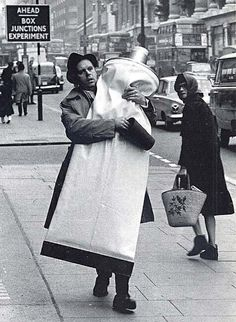 Claes Oldenburg with a monumental tube of toothpaste. London, 1966.
