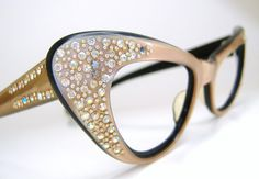 Very beautiful pair of cats eye frame with lots of aurora rhinestones. They are in good used vintage condition. Very beautiful frames. Strong five barrel hinges. Please note they have some very light fading above the right lens. Hardly noticeable. Not marked with a makers name. They have no lens in. Ready to have your Rx or sunglasses lens put in. Please ask any questions. I have more eyeglasses listed.Check out my shop for more unique vintage eyewear. http://www.etsy.com/shop&...
