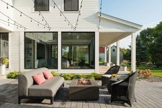 This modern farmhouse sits on an old farmstead in Lake Elmo. The homeowners wanted a comfortable home with an edge that celebrates the panoramic views of the rural site. A vintage white barn served as inspiration for the exterior material palette. The traditional gable form is paired with a corner of glass that accents the...