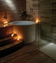 Japanese-style bathroom with round soaking tub.                                                                                                                                                                                 More