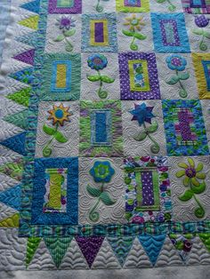 https://flic.kr/p/7akp5y | Flower Embroidery | Pieced by Bonnie Cope  Quilted by Jessica's Quilting Studio