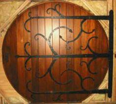 Love this door! & Round Hobbit House door. 3-inch-thick front door is made of Spanish ...