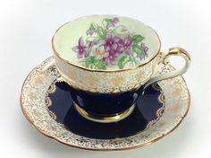 Antique Aynsley gold fleur de lis tea cup and saucer set made in England