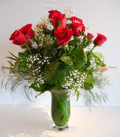 Change-it-up for Valentine's Day with this luxuriant vase arrangement of a dozen roses , and a few tulips for extra interest and beauty from Dizennio Floral Boutique