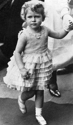 A look back at the British Royal family—from Queen Elizabeth II, Princess Diana, Prince William, Prince Harry to Zara and Peter Philips and more—as kids. Queen Mary, Queen Elizabeth Ii, Cute Black Heels, Queen 90th Birthday, Fourth Birthday, Sparkly Gown, Prinz Harry, Green Gown, Isabel Ii