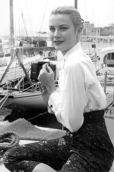 Grace Kelly in Cannes, France, 1955. See 51 more rare, vintage photos of celebrities enjoying summer.