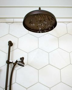 honeycomb tile + rubbed bronze rainfall shower head | brandon barre' photography