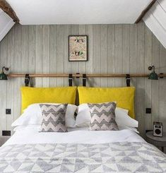 Grey & white bedroom with wood panelling in Small Space Design Ideas. Small white & grey attic bedroom with wood panelling, DIY headboard and yellow accents. Source by kellyrmount The post Small room ideas appeared first on Whitney DIY Design. Budget Bedroom, Small Room Bedroom, Trendy Bedroom, White Bedroom, Small Rooms, Small Spaces, Master Bedrooms, Warm Bedroom, Bedroom Wardrobe