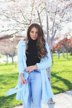 light weight jacket for spring with high waist jeans and curled balayage brunette hair