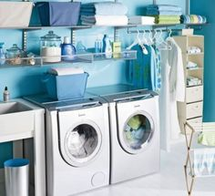 Organized laundry room- it would have a bigger washer and dryer though