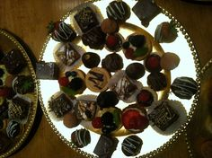 Fruit tart with Bavarian cream, peanut butter tart, caramel tart,  ganache filled figs dipped in chocolate, chocolate cake filled with salted caramel mousse, cream puffs filled with salted caramel mousse, cream puffs filled with Bavarian cream, patron cafe truffles, short bread cookies with ganache topped with a raspberry, florentine cookie cup filled with mousse and topped with strawberry slices. Rocky road brownies. Chocolate dipped strawberries filled with grand marnier.