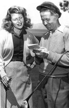Actress Rita Hayworth is seen here comparing scores with Glenbrook golf pro Floyd Hudson, circa 1940s.