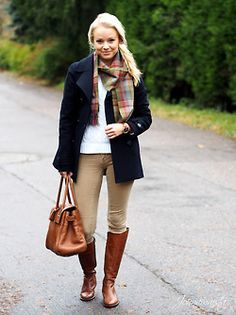 White tee, khakis, riding boots, navy coat, plaid scarf, and brown leather tote.