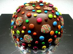 Pinata Birthday Cake - A hollow-ish chocolate cake ball filled with goodies which spill out after cake is whacked