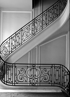 COCOCOZY: ELEGANCE IN PARIS - The most beautiful iron staircase railing in the world. Love the gray walls, the curve of the stairs and the detail in the railing. Perfect Paris apartment by designer Joseph Dirand!