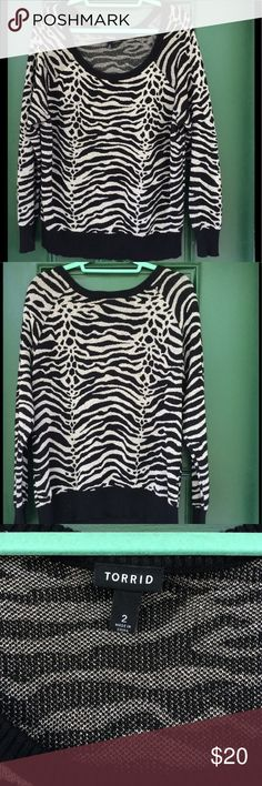 Torrid Gold Metallic Tiger Print Sweater This is a gently worn. It has no stains. It is very stretchy. I love it I just have way to many sweaters. No pets, no smoking and no smoking pets :) torrid Sweaters Crew & Scoop Necks
